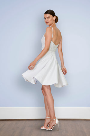 Bride wearing sweetheart neckline off white short wedding reception dress and cocktail dress