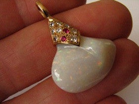 Solid white Opal pendant set with diamonds and rubies, hand made in solid yellow gold.