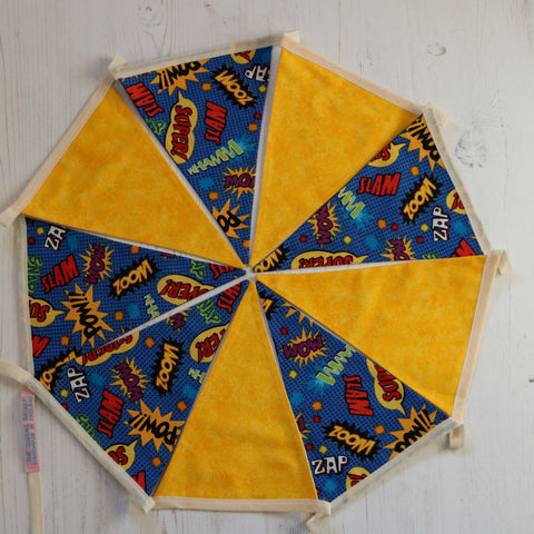 9 pennant string of cotton bunting; 5 pennants with comic strip quotes & 4 pennants in bright yellow