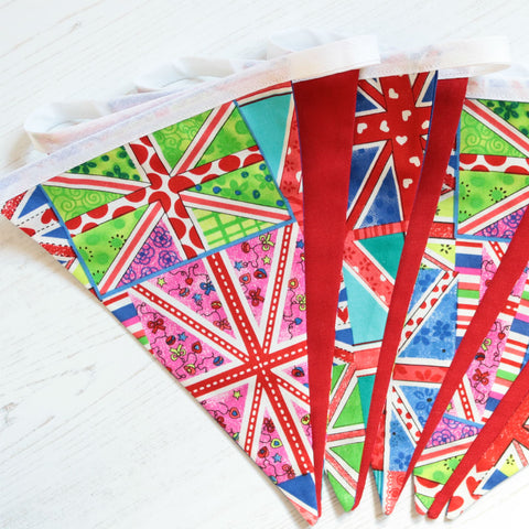 9 pennant string of cotton bunting with bright union jacks in different colours
