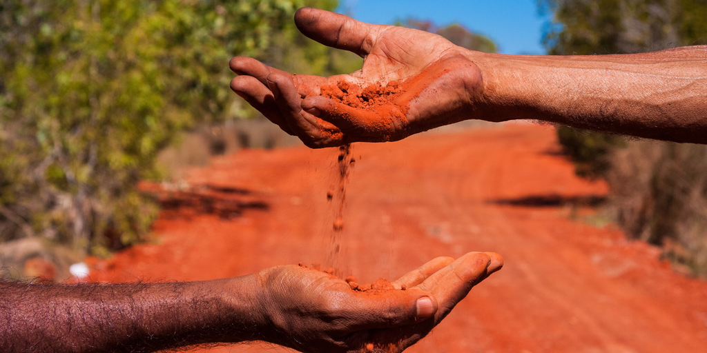 Ethical Aboriginal Art- pouring dirt into hands