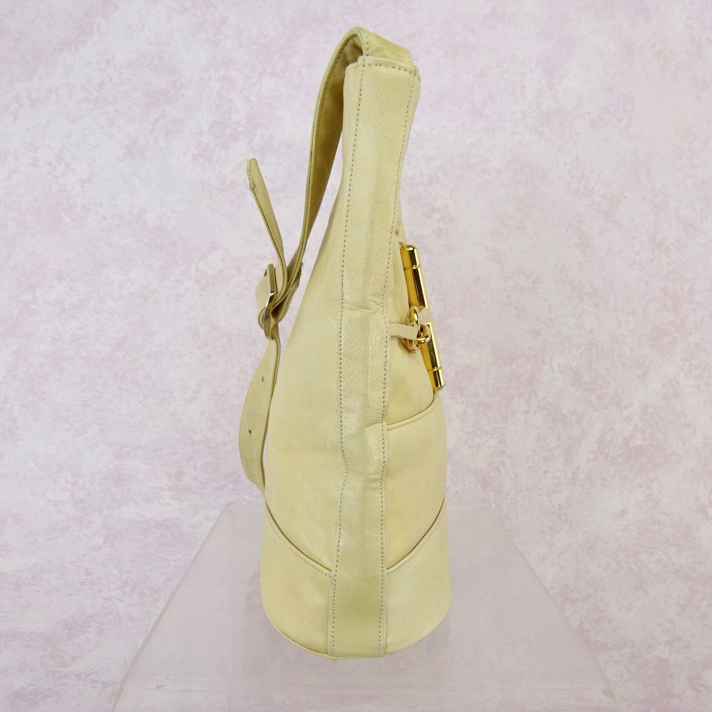 417f001e79 Vintage 80s Leather Pouch Bag w  Gold-Tone Stirrup – Voguely Familiar