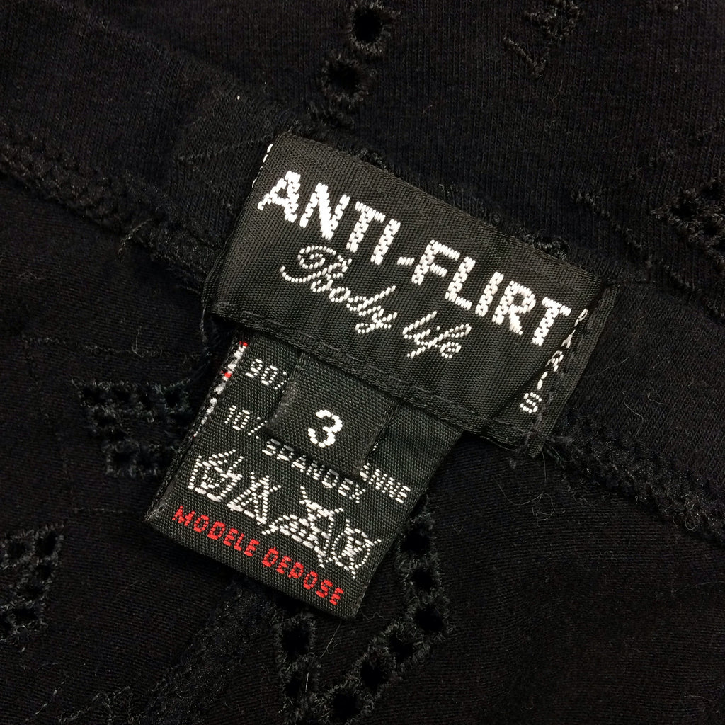 2000s ANTI-FLIRT Black Stretch Eyelet Leggings, Label