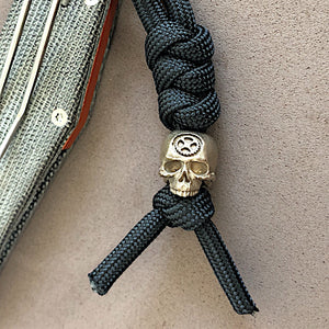 Bronze Skull Bead on Knife Lanyard