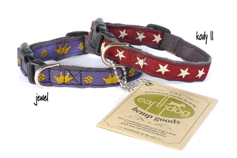 two dog collars one red with white stars one blue with yellow