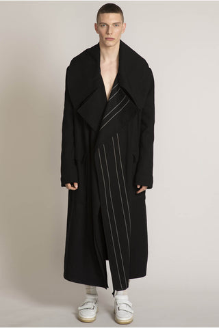 THE MIRACLE TRENCH COAT IN BLACK WITH ASYMMETRICAL ECRU DOUBLE PINSTRIPES