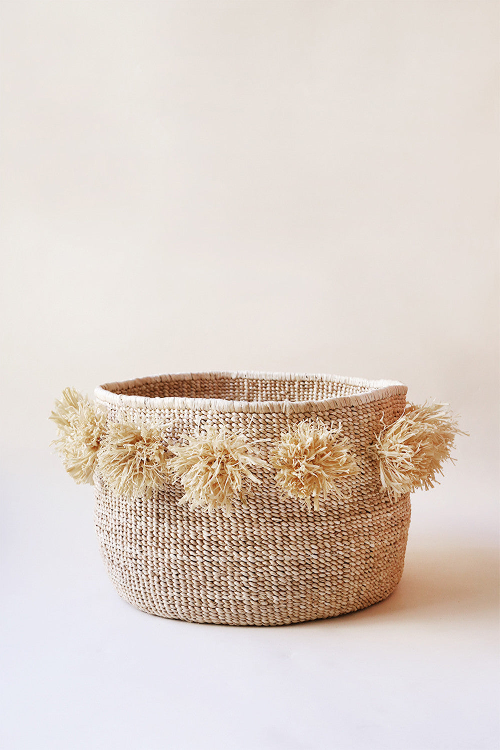 Pom Pom Banana Leaf Floor Basket in Natural