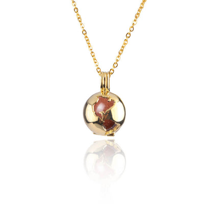 Golden Sand Globe Locket by Cristina Ramella
