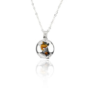 Sterling Silver Globe locket Eye stone by Cristina Ramella