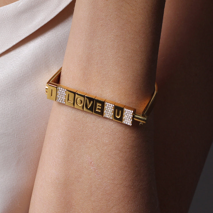 Wearing I love you Bricks Bracelet by Cristina Ramella