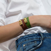Wearing World Map Leather Bracelet by Cristina Ramella