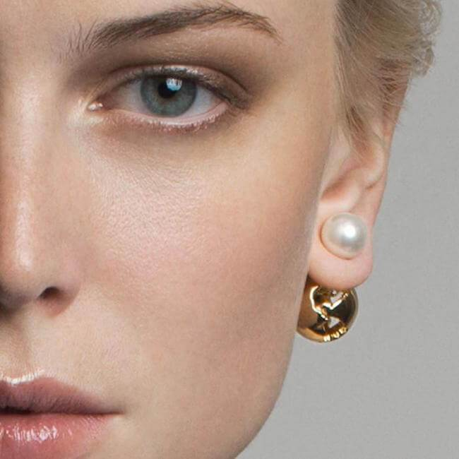 Wearing Globe Pearl Earrings