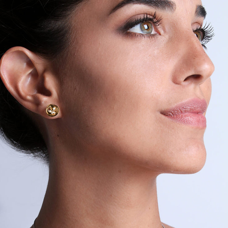 Wearing Gold Small Earrings by Cristina Ramella