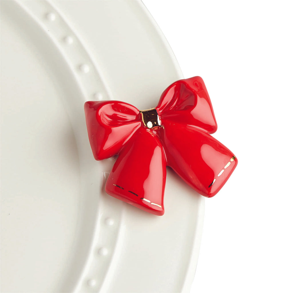 "Nora fleming mini mini figure ceramic minis gift present bow red bow ""wrap it up"" christmas christmastime winter presents deck the halls festive"