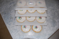 Olympic Cookies on layered trays in Bakers Sto N Go