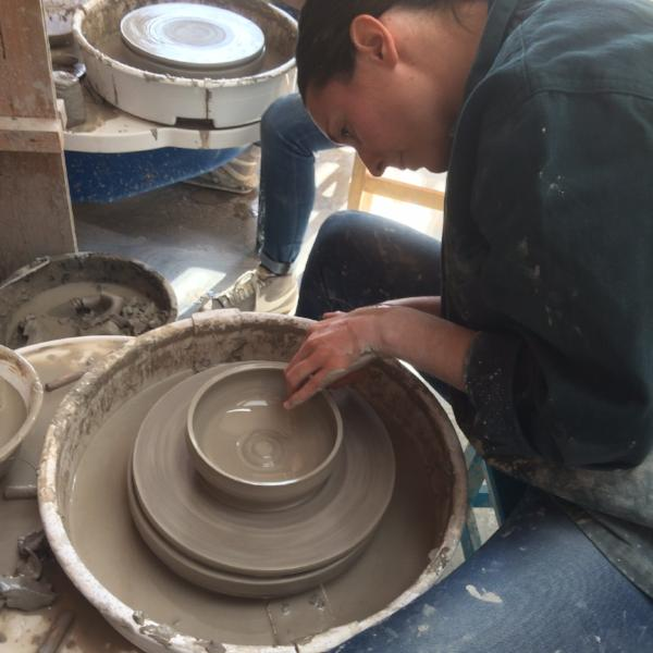 Throwing a bowl on the pottery wheel