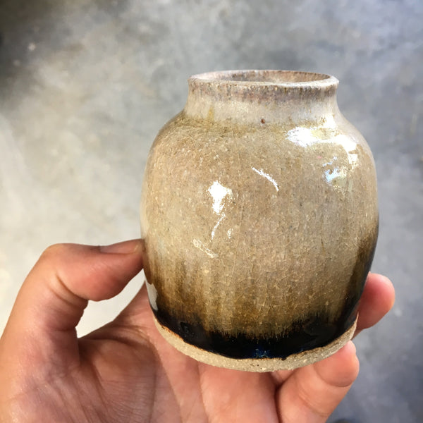 A thrown and glazed handmade pottery vase