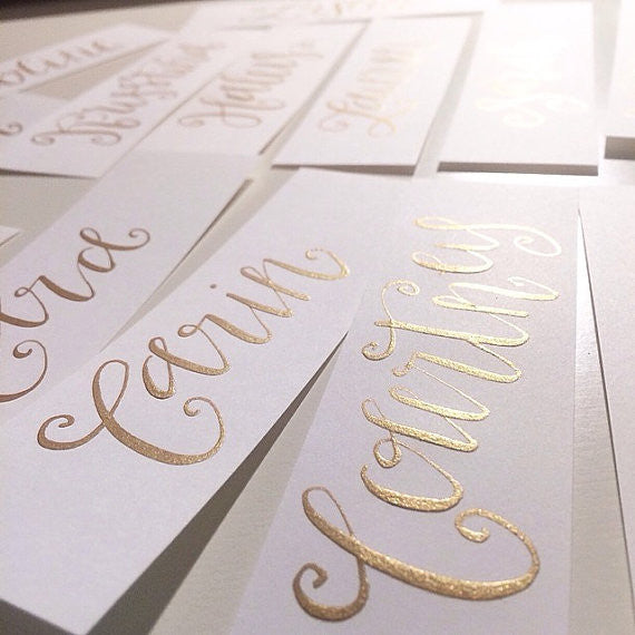 Gold calligraphy place cards all she wrote notes