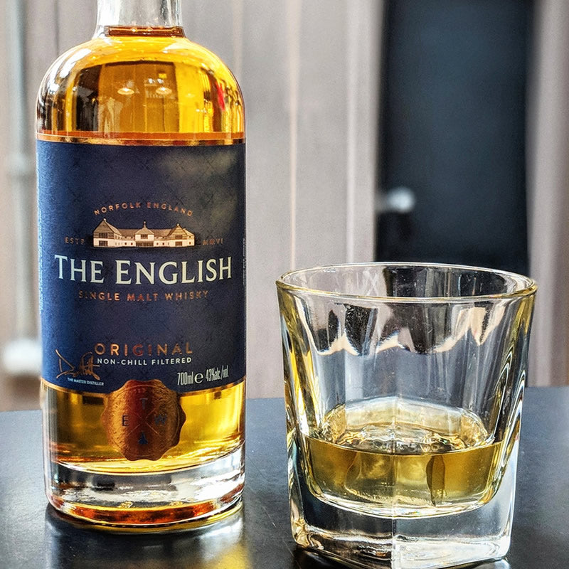 Bottle and glass of English whisky