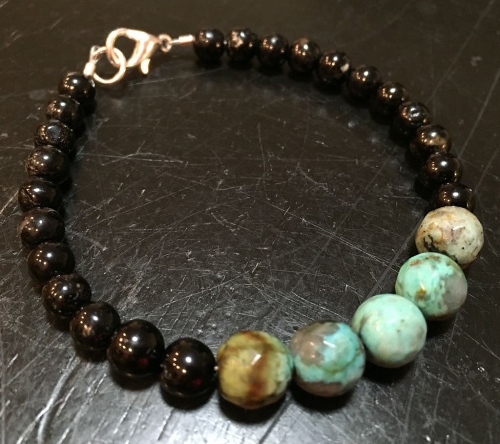Sterling silver bracelet featuring African turquoise with black tourmaline
