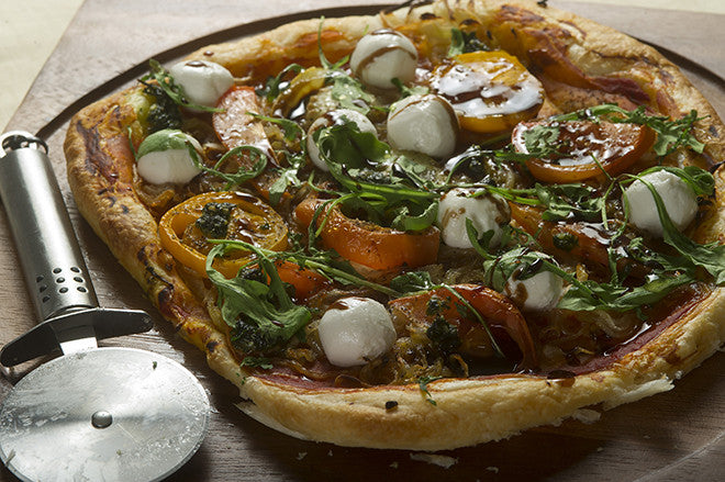 PUFF PASTRY PIZZA WITH BALSAMIC ONIONS, HEIRLOOM TOMATOES & MOZZARELLA PEARLS