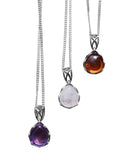 Intricate Gemstone Pendant with silver chain