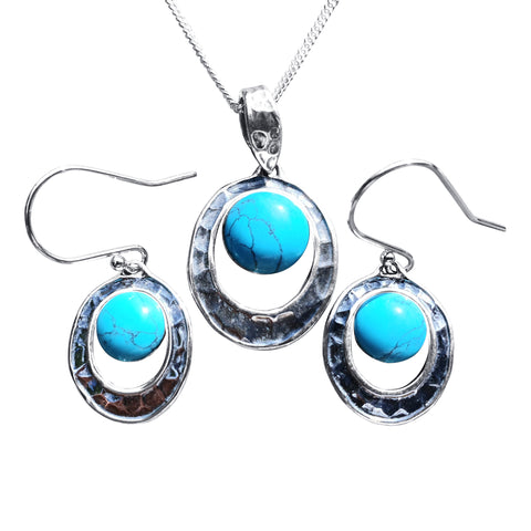 Turquoise Pendant and Earrings set in Hammered Silver