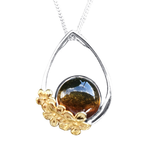 Floral Amber Pendant with gold accent