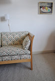 Rotang 2 seater sofa by Arne Norell. Side sections and back with woven cane