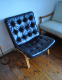 Danish modern black leather lounge chair