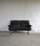 Dark brown leather and chrome 2 seater sofa by Arne Norell