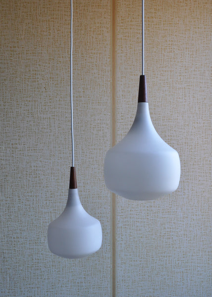 Holmegaard minimalistic hanging lamp in opaline glass and teak, set of 2