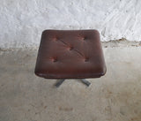 Reddish brown leather and chrome lounge chair and stool by Arne Norell