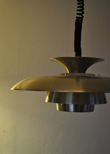 A classic danish multilayered brass pendant
