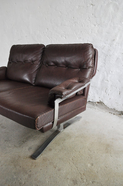 Reddish brown leather and chrome sofa by Arne Norell