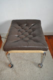 Stool upholstered in brown leather