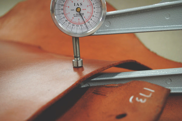Testing our Veg. Tanned Leather for Consistency with a Leather Gauge