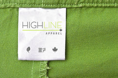 A clothing label with the HighLine Apparel logo sewn in.