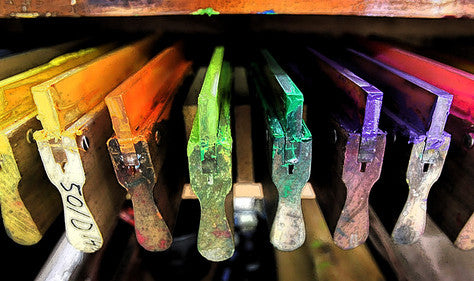 Squeegees after having painted a brilliant rainbow of vivid colors