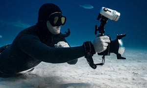 Freediver Photographs Sharks Underwater with OMNA Tourniquet Camera Tether