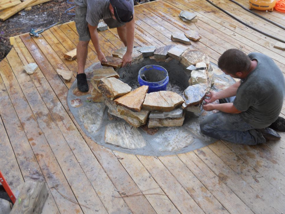 Hand crafter fire pit and stone insert