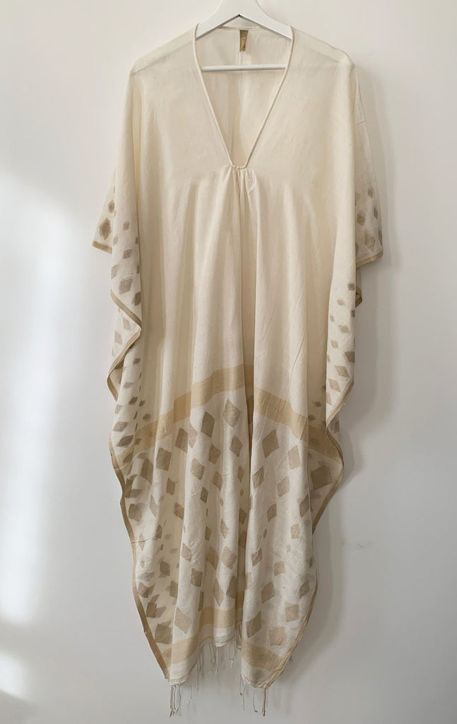 Natural caftan with handwoven motif