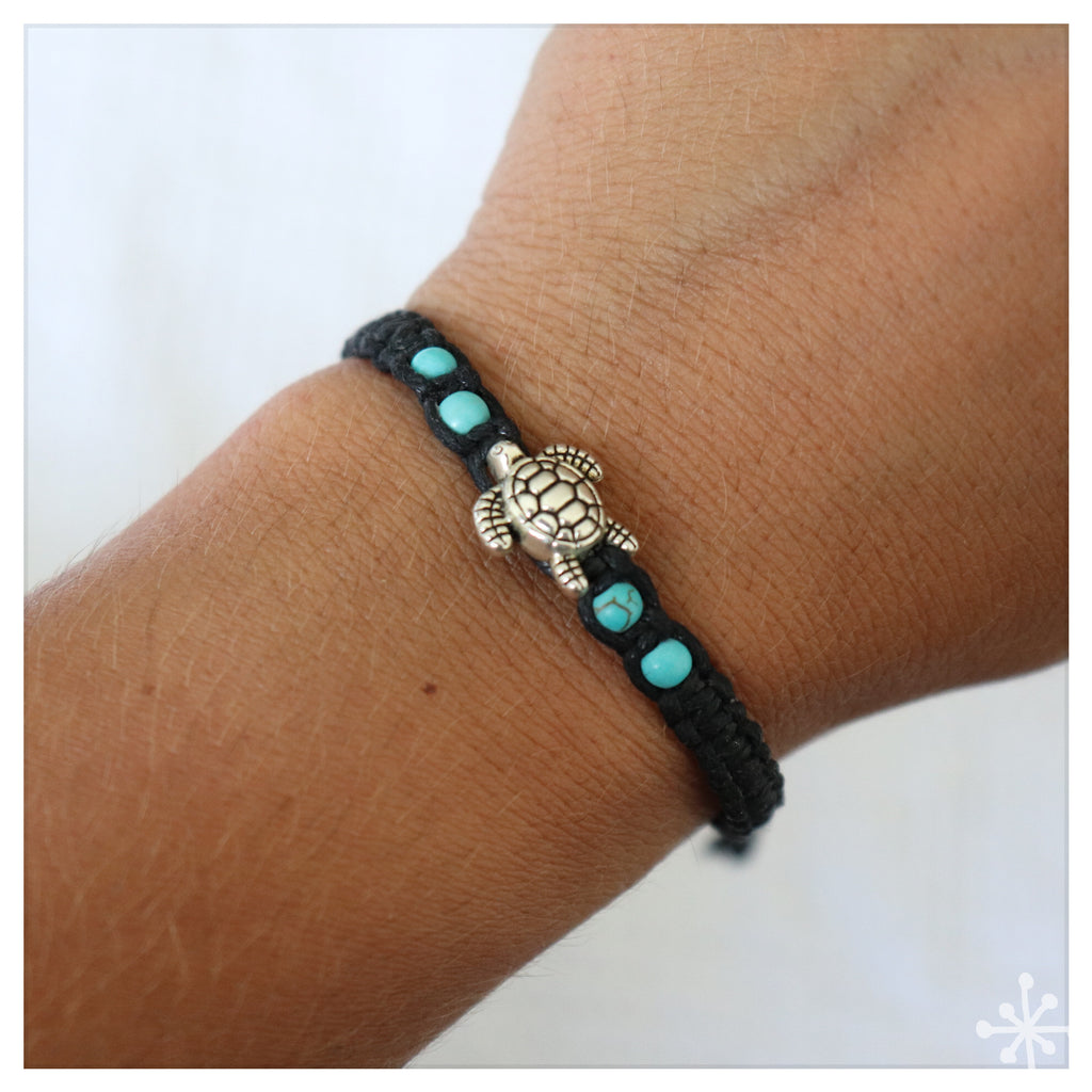 Hand made bracelet with turtle pendant on black cord with blue beads