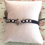 Hand made bracelet with turtle pendant on black cord with cream beads