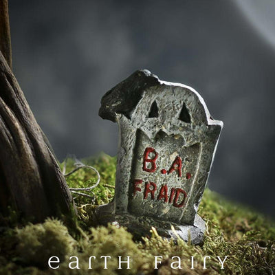Miniature B. A. Fraid Tombstone, shown in a garden setting, from The Fairy Garden Miniature Halloween Collection by Earth Fairy
