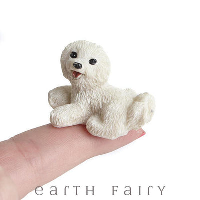 MMiniature Bichon Frise Dog, shown sitting on finger tip,  from The Fairy Garden Miniature Animal Collection by Earth Fairy