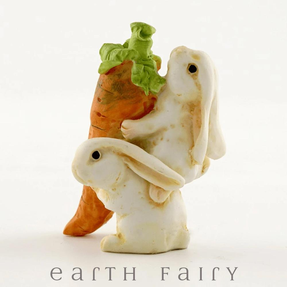 Bunnies Lifting a Carrot