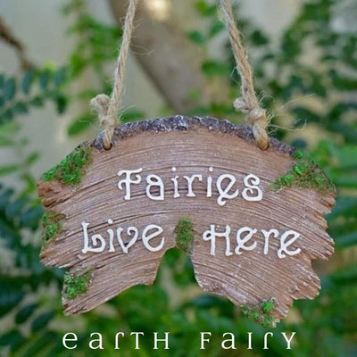 Fairies Live Here Plaque, displayed in a garden setting, from The Fairy Garden Decor Collection by Earth Fairy