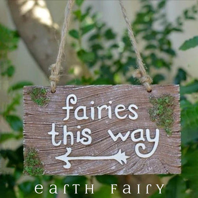 Fairies This Way Garden Plaque, displayed in a garden setting, from The Fairy Inspired Gift Collection by Earth Fair