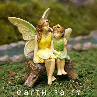 Fairy Sisters Sitting on a Bench in a Garden Setting from The Woodland Knoll Fairy Garden Collection by Earth Fairy